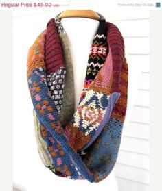 """mix of Fair Esle knits and solids for this giant loop scarf. I have serge machine stitched the patchwork seams and chain stitched by hand the closure of the scarf.    Measurements ~  mid weight  length~42""""  width~ 5.5"""""""