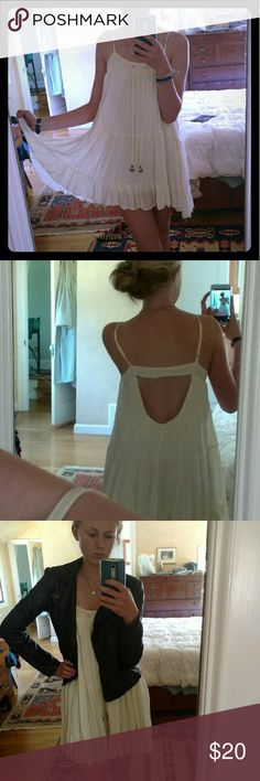 Gorgeous flowy white casual dress Float white casual dress, low back, cute and can be dressed up or down. Very good quality only worn once. Dresses Mini