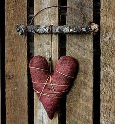 Prim Heart...lichen covered stick...some old wire...painted burlap heart - stuffed.
