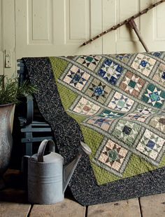"""Scrappy """"Antique Star"""" quilt featuring Civil-War era colors and prints. From the book Tributes and Treasures by Paula Barnes and Mary Ellen Robison of Red Crinoline Quilts."""