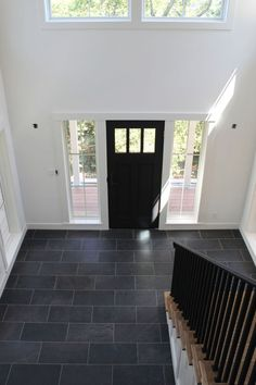 White walls, black door, and tile floor . all that's needed is a good accent c. White walls, black door, and tile floor … all that's needed is a good accent color! Entryway Tile Floor, Entryway Flooring, Tiled Hallway, Slate Flooring, Kitchen Flooring, Flooring Ideas, Entry Tile, Slate Floor Kitchen, Black Hallway