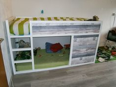 Check out this IKEA fan's rustic DIY project using reclaim wood and white paint on the KURA bed!