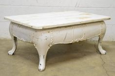 """Columbus Architectural Salvage - Stove Base Coffee Table repurposed coffee table constructed of a salvaged vintage/antique cast iron wood burning stove base and a wooden top. This piece measures approximately 36"""" wide x 15"""" tall x 23"""" front to back."""