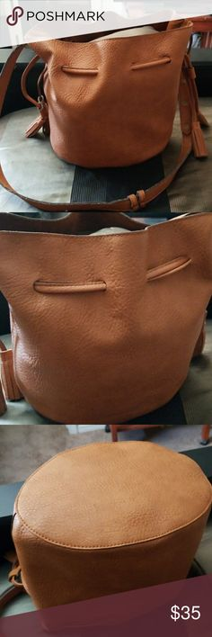 Free People Bucket Bag Make me an offer using the offer tool. Cute medium size bucket bag. Ver good condition. Vegan leather on the outside suede inside.A drawstring closure, tassel-accented ends, and faux suede lining. cruelty-free. Free People Bags