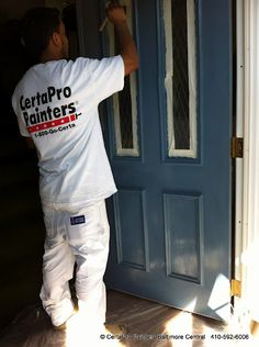 """Front door being painted Smoky Blue SW 7604 on a beautiful spring day. Usually the first items CertaPro Painters preps and paints  are doors, since customers need to leave open for a few hours until """"Hard-Dry""""  #Sherwin Williams"""