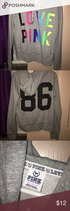 VS Pink hoodie Grey hoodie with rainbow printed graphic on front. The back of the hoodie has '86' in black. Has been worn but is in excellent condition and comes from a smoke free home! PINK Tops Sweatshirts & Hoodies