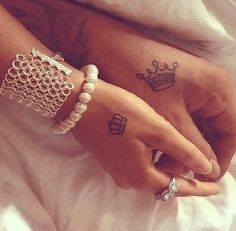 Matching couples crown tattoos, crow tattoo, couple's tattoos, hand tattoo, small tattoo