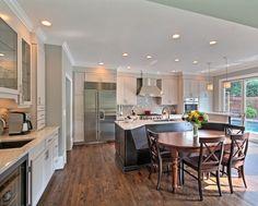 Open kitchen with bench seating area. White cabinets. Kitchen Remodel by CSI Kitchen & Bath Studio #kitchenrenovation