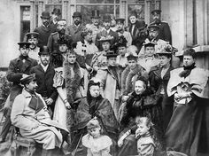 1884 Queen Victoria traveled to Coburg, Germany for a relative's wedding.    She is pictured among members of her large family including such prominent figures as the future Edward VII, the future King George V, the Duke of Saxe-Coburg-Gotha, the German dowager Empress Friedrich, the future Tsar Nicholas and Alexandra of Russia, and Kaiser Wilhelm II of Germany.