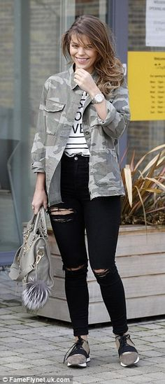Casual style: Covering up with a camouflage print jacket, the pretty brunette completed he...