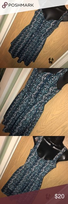 """Ditsy floral tank dress Super cute ditsy floral print tank dress with pockets. Great used condition. Size L. Polyester/spandex. 17"""" from armpit to armpit, 25"""" from armpit to hem. BeBop Dresses Mini"""