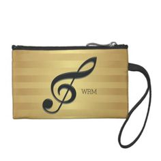 Would you like this in a different color combination? Please contact us through our GiftsBonanza store and we will be happy to create it for you. A stylish and elegant music design featuring a large treble clef in black on a golden colored striped pattern background. Customize the text with your own monogram initials for a personalized musical design. Please note the satin raised effect of the treble clef and the golden color are printed effects, there are no raised edges or gold foil on the…
