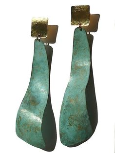"""Artsy yet classic, Sibilia for IMPERIO jp earrings can be found in museum shops from London to Tokyo, and now on Taigan. These are the long swirls in vermeil with a patina finish, super lightweight. Please avoid spraying perfume or showering/swimming with these earrings as it may affect the Patina...  About 4"""" long"""