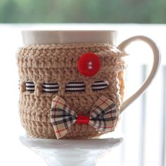"Crocheted Burberry Mug Cozy. Cup size: Diameter 3""; Height 4"" You'll need: no 4 crochet hook; medium no 4 yarn; tapestry needle; Ribbon of your choice to make bow; Ribbon about 7 mm width; button about 1"" diameter"
