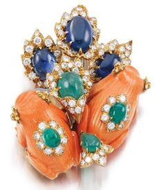 A coral, emerald, sapphire and diamond brooch by David Webb.