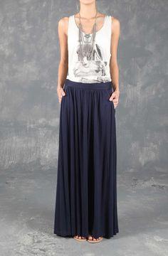 Falda femenina larga, fondo entero. Compra en Tennis.com.co - tennis