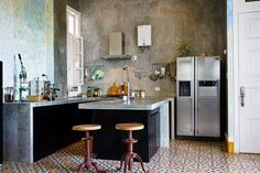 Image 1 of 6. Conceptual artist Wilfredo Prieto's kitchen. He designed the kitchen himself and had it made by local craftspeople. Image Courtesy of Hannah Berkeley Cohen via Curbed