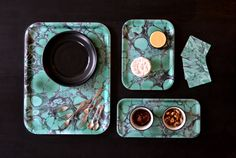 Our unique design, 'Deep Jade', displayed in 3 different sizes - serving, breakfast, cocktail - and coasters. #studioformata #marbling #papermarbling