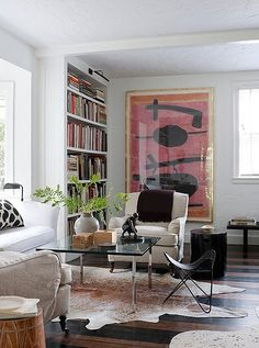 Though not initially obvious, the painted striped floors of this space are decidedly chic and take the room to a new level of sophistication.
