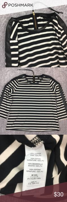 """J Crew Leather Striped Rugby Sporty Tee Shirt XL J. Crew Black & White Stripes 3/4 sleeves tee shirt. Faux leather striped trim to add a sporty more luxe vibe for a tee shirt. Thicker than an average tee shirt. Faux leather zipper pull tassel that draws attention to the back. Super cute athleisure style. Excellent condition. Bust: 43"""" Length: 25.5"""" J. Crew Tops Tees - Long Sleeve"""