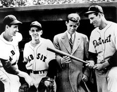 In honor of 100th Opening Day — John F. Kennedy meets with Ted Williams and Eddie Pellagrini of the Boston Red Sox, and Hank Greenberg of the Detroit Tigers at Fenway Park, Boston, April 1946.