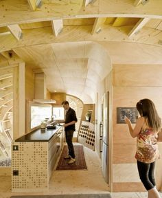 Kitchen has a good amount of space, and love the placing of the  fridge!!!  Tiny Solar House by IAAC the Fab Lab Project