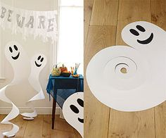 DIY` Spinning Spirits: Hung from the ceiling, these friendly paper ghosts will swirl, sway, and spook all night long.