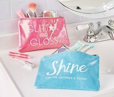 Iridescent cosmetic bags for all the shine she can carry.