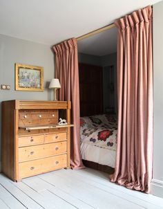 Curtained alcove bed in the London flat of designer Patrick Williams of Berdoulat   Remodelista