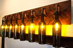 No clue where I'd put it, but LOVE the idea! Wine Bottle Light Lamp - Industrial - Vanity - Sconce - Chandelier. $542.00, via Etsy.