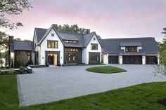 Transitional Lake House Interior Design Ideas Black trim home Stucco home exterior with black trim black garage door black front door Black accents beautifully complements the stucco siding Café Exterior, Design Exterior, Dream House Exterior, Dream House Plans, Lake House Plans, Dream Houses, Black Trim Exterior House, Big Houses Exterior, House Exterior Design
