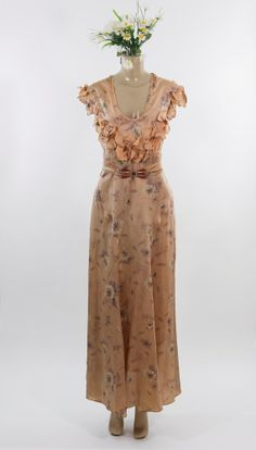The 50s got me into vintage clothing, but as of late, I've been into 30s silhouettes and floral print like this one.