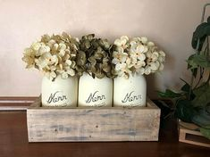 Mason Jar Centerpiece with Planter Box This beautiful mason jar centerpiece would look lovely displayed on your table for the any occasion. It also would make a great gift. Hydrangea Colors (leave in note to seller) - Antique White - Apple Green - Burnt Orange - Brown - Dark Red