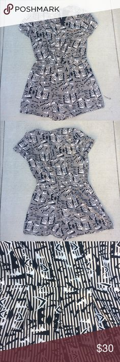 Forever 21 romper Forever 21 black and white patterned romper. Super comfy. V-neck in the front. Perfect for a cute and comfy summery vibe. Forever 21 Other