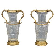 Pair of Baccarat Handblown, Crystal Vases with Wheel Cut Engraving and Bronze Mounts | From a unique collection of antique and modern vases at https://www.1stdibs.com/furniture/dining-entertaining/vases/