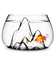 Elevate your guppy's landscape with hand-blown glass mountains.