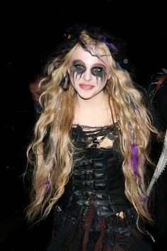 """Gearing up for her role in the remake of the horror classic """"Carrie""""? Chloe Grace Moretz gets into the Halloween spirit dressed as a zombie on Oct. 31, 2012 in London."""
