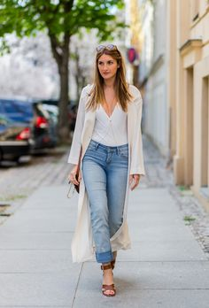 BERLIN, GERMANY - APRIL 24: Sofia Grau is wearing blue Levis denim jeans, a white Zara top thsirt, a white long trench coat and bown sandals with heels from &otherstories, a red brown Chloe Faye shoulder bag suede leather, Ray Ban sunglasses, and Cornelia Webb body chain on April 24, 2016 in Berlin, Germany (Photo by Christian Vierig/Getty Images)