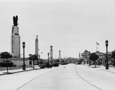 (ca. 1937)* - View of Westwood Boulevard, looking north from south of Wilshire Blvd. On the left, there are several gas and service stations, including a Richfield, Associated, Union 76, and Chevron. On the right are various stores, including a Ralphs supermarket.
