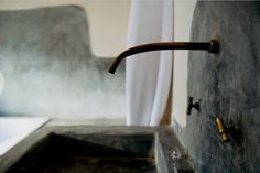 Wabi-Sabi: the Japanese aesthetic of imperfection - traditional Moroccan copper bathroom sink spigot and handles