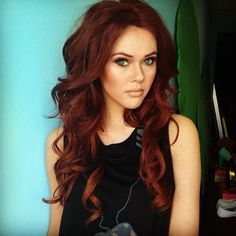 Beautiful red hair color....perfect to add for winter...a few highlights!