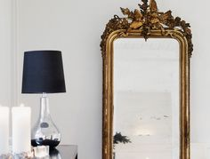 Placing a full-length mirror in the entranceway would give the illusion of a bigger, grander space instantly. Opt to place the mirror against a wall right in front of the doorway for the desired impact.
