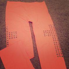 Leggings Never worn leggings with studded cross design on sides of both legs Pants Leggings