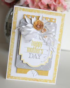 handmade Mother's Day card ... white, pale gray and yellow ... trendy colors ... fluffy bow ... lots of layers ... pretty papers ...