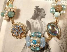 Vintage jewlery repurposed.  Love, love love!