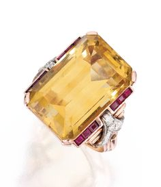 ROSE GOLD, CITRINE, RUBY AND DIAMOND RING Centered by an emerald-cut citrine weighing approximately 35.00 carats, flanked by 12 calibré-cut rubies, the mounting accented by round diamonds weighing approximately .60 carat, size 6, fitted with inner sizing band; circa 1940.
