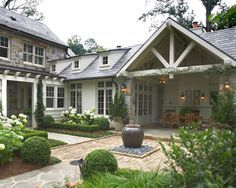 like the outdoor covered patio right off the house. We need some covered area off the house  like the style too. white painted brick mixed with beautiful stone