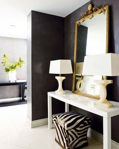 swap out for a silver framed mirror, and glass lamp bases and this is gorgeous
