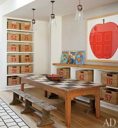Love the worn table with the checkerboard surface.  Perfect play room with lots of storage!