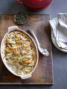 Thinly sliced potatoes soak up heavy cream perfumed with garlic and fresh herbs in this decadent gratin.